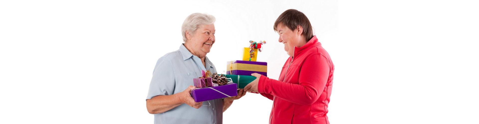 senior exchanging gifts