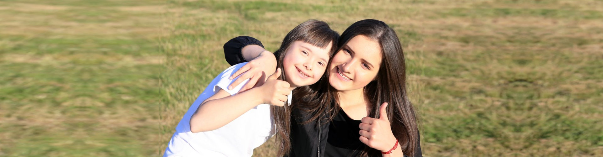 woman with a kid showing thumbs up